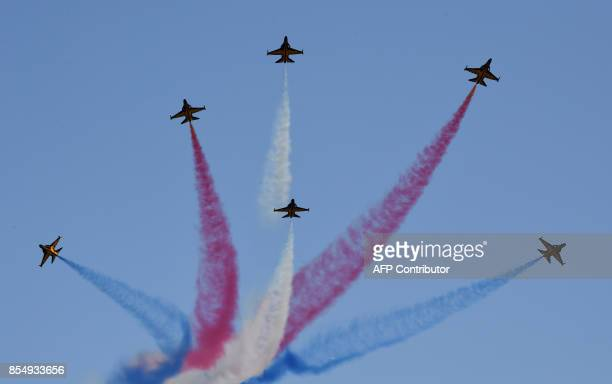South Korea's Air Force Black Eagles aerobatic team perform during a commemoration ceremony marking South Korea's Armed Forces Day which will fall on...