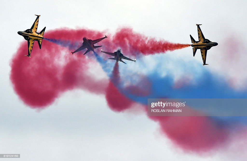 South Korea's Black Eagles aerobatics team performs an aerial display during a preview at the Singapore Airshow at Changi exhibition center in Singapore on February 14, 2016. The Singapore Airshow 2016 begins on February 16 to 21. AFP PHOTO / ROSLAN RAHMAN / AFP / ROSLAN RAHMAN