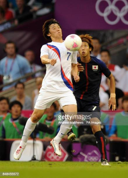 South Korea's BoKyung Kim and Japan's Yuki Otsu during the men's football Bronze medal match between Japan and South Korea at the Millennium Stadium...