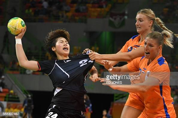 TOPSHOT South Korea's centre back Gwon Han Na vies with Netherlands' left back Kelly Dulfer and Netherlands' centre back Nycke Groot during the...