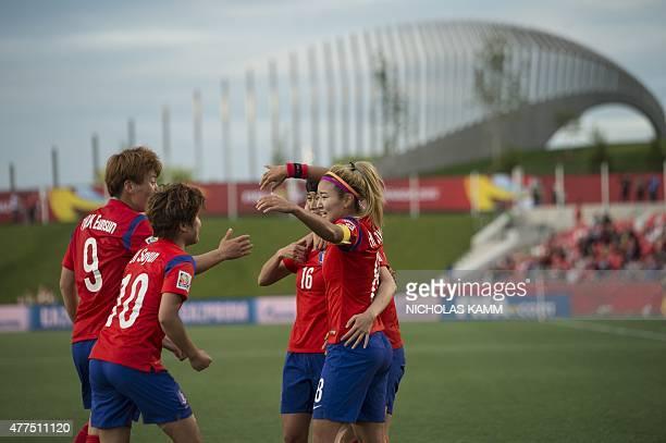 South Korea's Cho Sohyun celebrates scoring against Spain with Kang Yumi Kim Eunsun and Ji Soyun during a 2015 FIFA Women's World Cup Group E match...