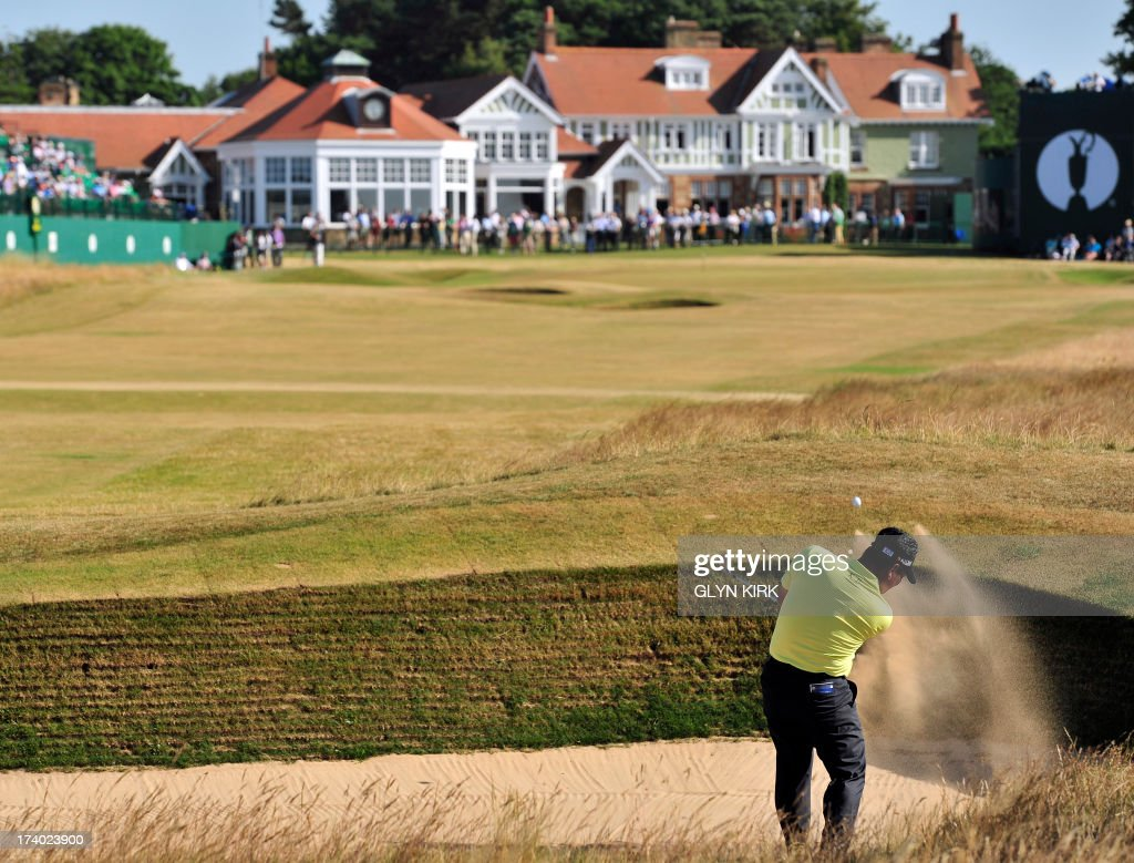 South Korea's Choi Kyung-Ju (AKA KJ Choi) plays a shot out of a bunker onto the 18th green during the second round of the 2013 British Open Golf Championship at Muirfield golf course at Gullane in Scotland on July 19, 2013 . AFP PHOTO/GLYN KIRK