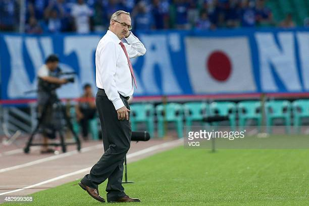 South Korea's coach Uli Stielike reacts in group match between Japan and South Korea during EAFF East Asian Cup 2015 at Wuhan Sports Center Stadium...