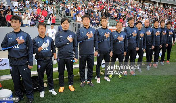 South Korea's coaches and players listen to their national anthem before a preWorld Cup friendly match with the US in Carson California on February 1...
