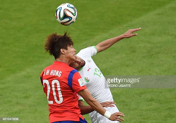 South Korea's defender Hong JeongHo fights for the ball with Algeria's forward Islam Slimani during a Group H football match between South Korea and...