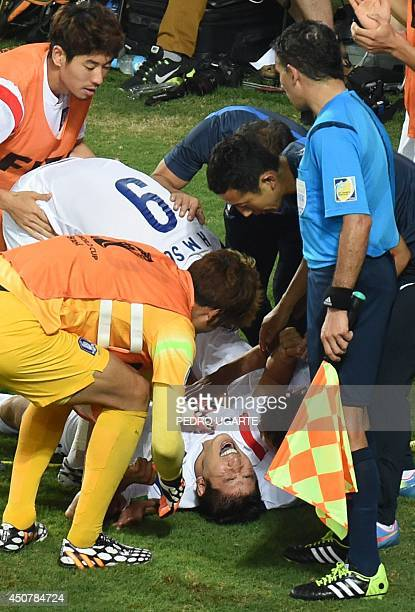 South Korea's defender Hong JeongHo reacts to an injury during a Group H football match between Russia and South Korea in the Pantanal Arena in...