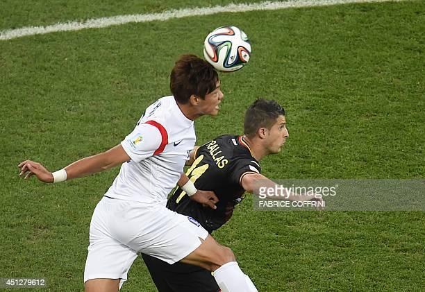 South Korea's defender Hong JeongHo vies with Belgium's forward Kevin Mirallas during a Group H football match between South Korea and Belgium at the...