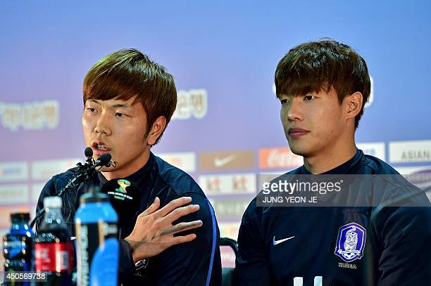 South Korea's defender Kim YoungGwon and defender Hong JeongHo attend a press conference before a training session in Foz do Iguacu Parana on June 13...
