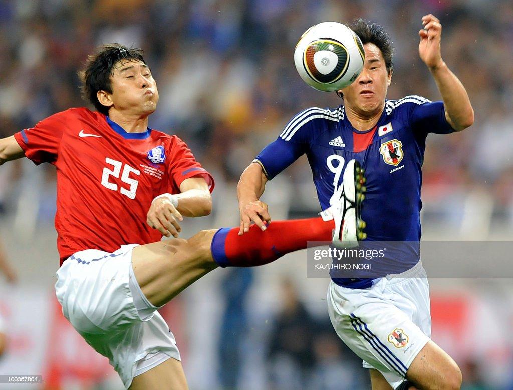 South Korea's defender Lee Jung-Soo (L) and Japaan's forward Shinji Okazaki fight for the ball during their international friendly football match at Saitama Stadium, suburban Tokyo on May 24, 2010. South Korea won the match 2-0. AFP PHOTO/Kazuhiro NOGI