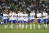 South Korea's defender Lee JungSoo celebrates with teammates after scoring during their Group B first round 2010 World Cup football match on June 22...