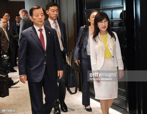 South Korea's Defense Minister Han MinKoo and his Japanese counterpart Tomomi Inada walk to meet US Pentagon chief Jim Mattis for a trilateral...