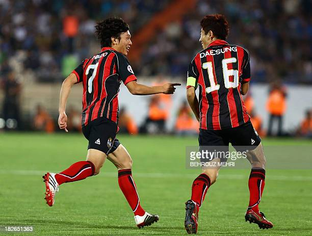 South Korea's FC Seoul Ha DaeSung and Kim JuYoung celebrate after scoring a goal against Iran's Esteghlal during their AFC Champions League SemiFinal...
