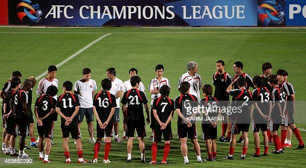 South Korea's FC Seoul players get ready for a training session at the Qatar club in Doha on September 22 ahead of their AFC Champions League quarter...