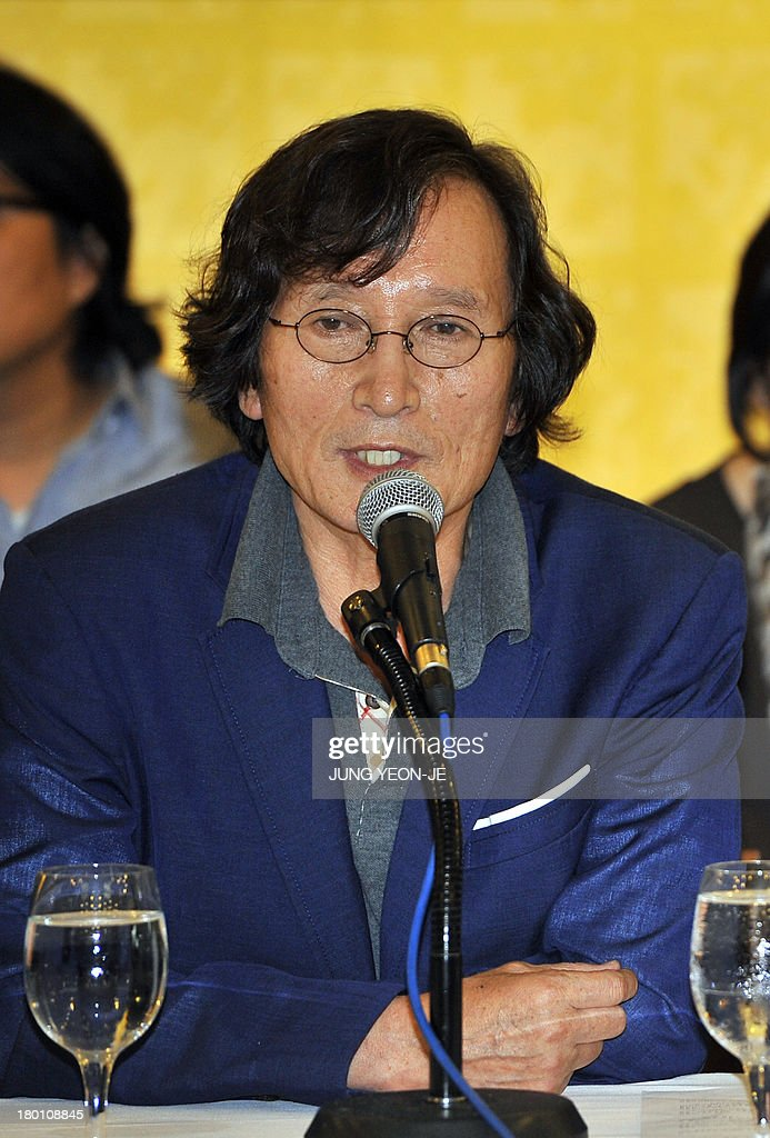 South Korea's firebrand director Chung Ji-Young speaks during a press conference against the decision to stop screening the documentary film 'Project Cheonan Ship' produced by Chung in Seoul on September 9, 2013. South Korea's film community reacted angrily to a major cinema chain's decision to stop screening the documentary that questions whether North Korea was really behind the 2010 sinking of the warship Cheonan.