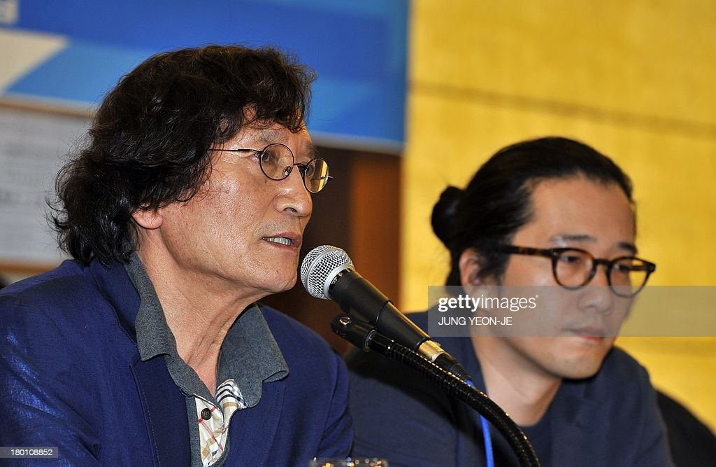 South Korea's firebrand director Chung Ji-Young (L) speaks during a press conference against the decision to stop screening the documentary film 'Project Cheonan Ship' produced by Chung in Seoul on September 9, 2013. South Korea's film community reacted angrily to a major cinema chain's decision to stop screening the documentary that questions whether North Korea was really behind the 2010 sinking of the warship Cheonan.