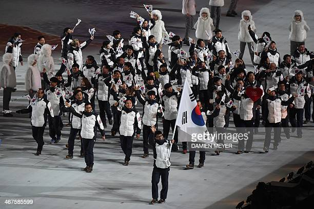 South Korea's flag bearer speed skater Lee KyouHyuk leads his national delegation during the Opening Ceremony of the Sochi Winter Olympics at the...