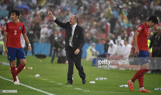 South Korea's football coach Ulrich Stielike from Germany shouts from the touchline against Iraq during their AFC Asian Cup semifinal football match...