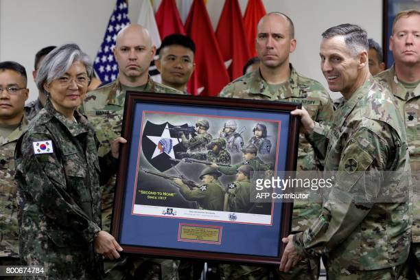 South Korea's Foreign Minister Kang KyungWha receives a gift from Lieutenant General Thomas Vandal commander of the US 8th Army as she visits the...