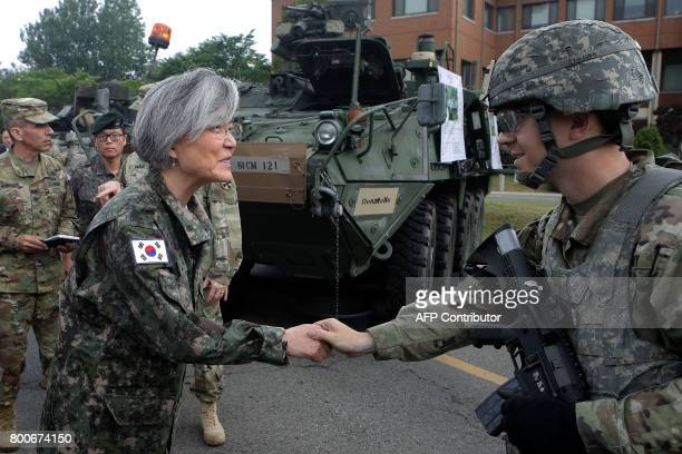 South Korea's Foreign Minister Kang Kyungwha shakes hands with a US soldier as she visits the headquarters of the South KoreaUS Combined Division2nd...
