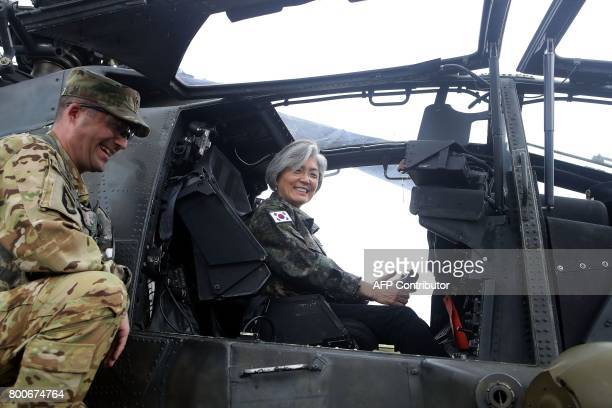 South Korea's Foreign Minister Kang KyungWha sits in a AH64D Apache longbow helicopter as she visits the headquarters of the South KoreaUS Combined...