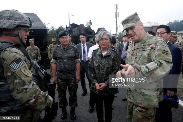 South Korea's Foreign Minister Kang KyungWha talks with Lieutenant General Thomas Vandal commander of the US 8th Army as she visits the headquarters...