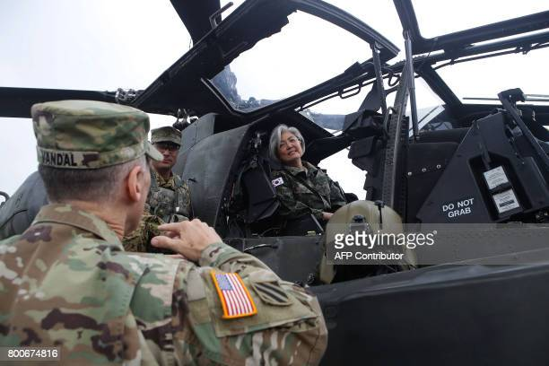South Korea's Foreign Minister Kang KyungWha talks with Lieutenant General Thomas Vandal commander of the US 8th Army as she sits in a AH64D Apache...