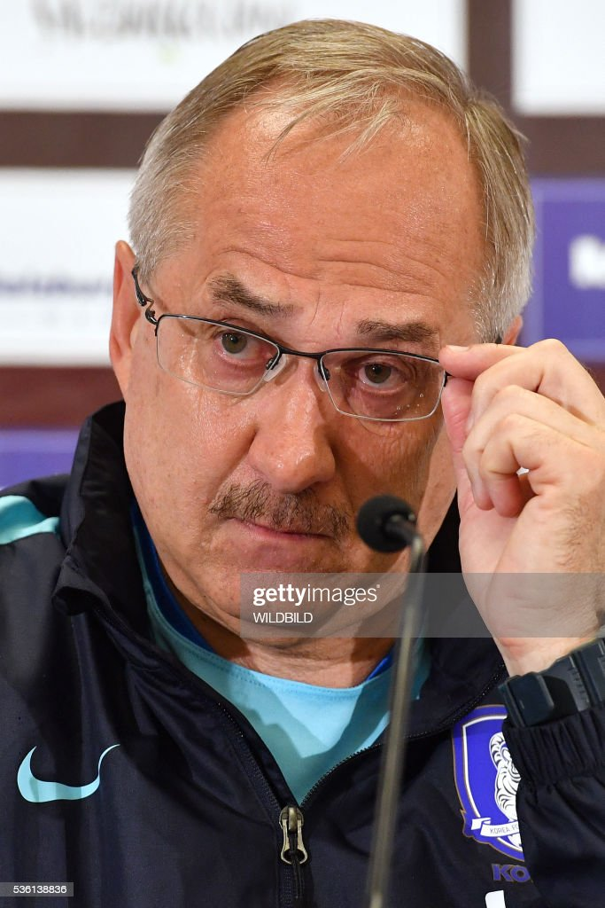 South Korea's german head coach Uli Stielike addresses a press conference in Schruns on May 30, 2016 in preparation for the upcoming Euro 2016 European football championships. / AFP / WILDBILD
