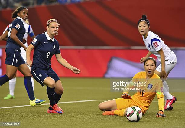 South Korea's goalkeeper Jun Minkyung defender Shim Seoyeon ad France's Eugenie Le Sommer watch MarieLaure Delie's shot enter the net during a 2015...
