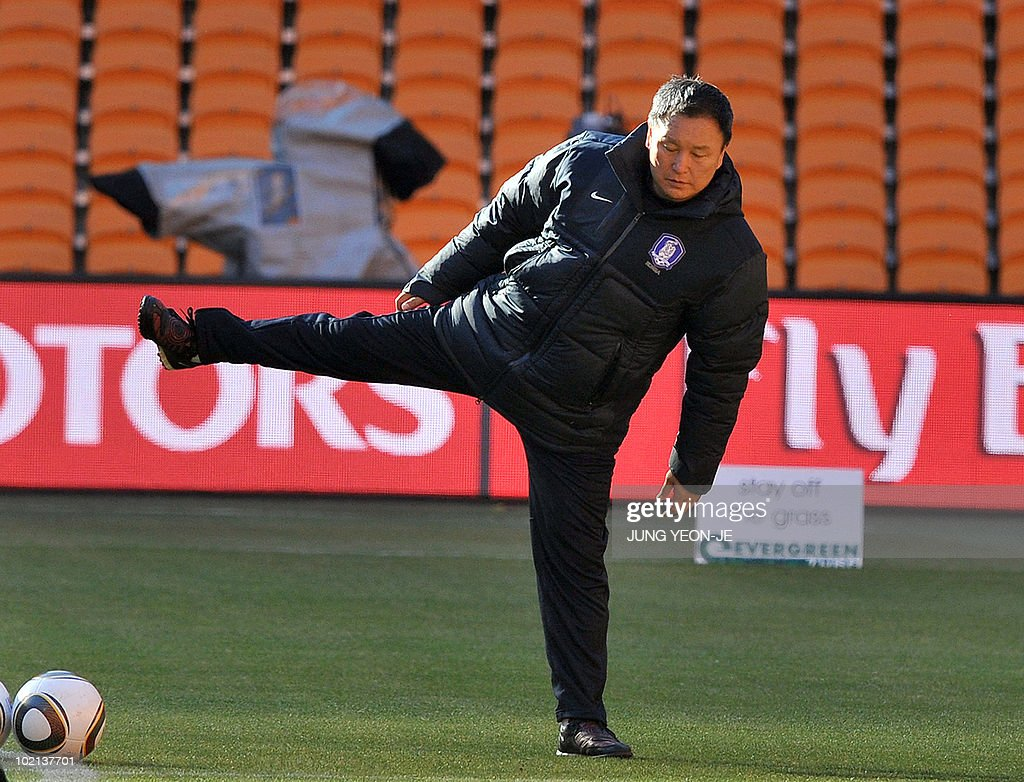 South Korea's head coach Huh Jung-Moo stretches during a team training session at Soccer City Stadium in Johannesburg on June 16, 2010. South Korea will face Argentina on June 17 as part of Group B of 2010 World Cup football tournament in South Africa.