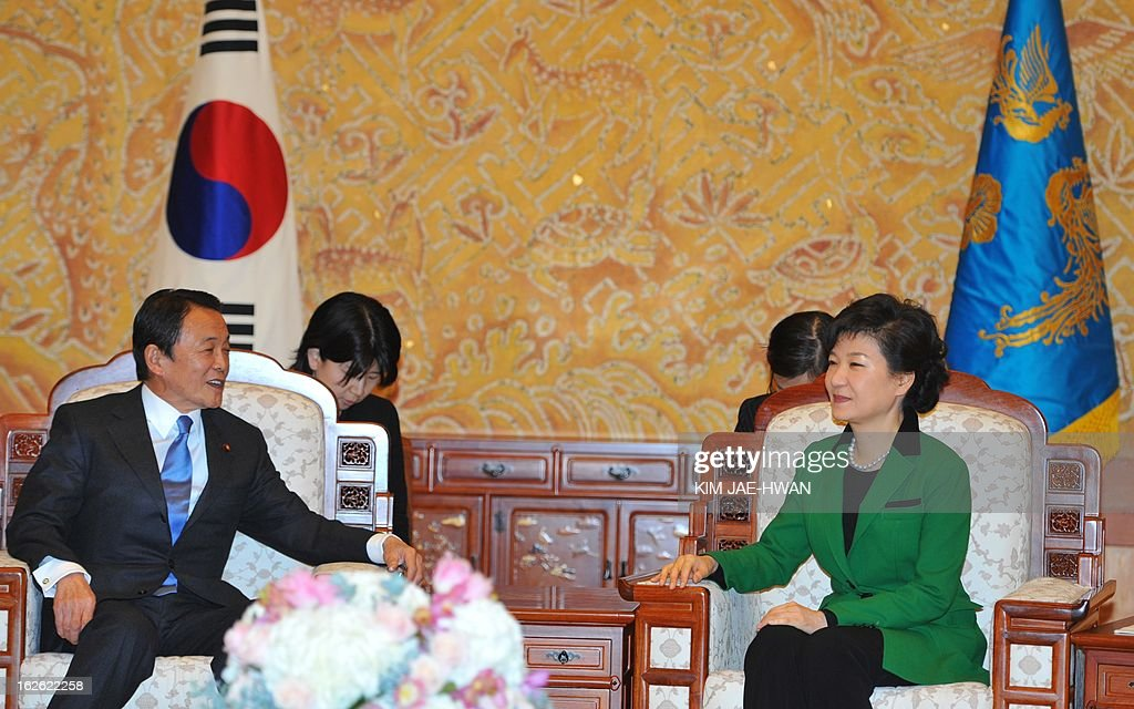 South Korea's incoming president Park Geun-Hye (R) meets with Japan's deputy prime minister Taro Aso at the presidential Blue House in Seoul on February 25, 2013. Park Geun-Hye became South Korea's first female president on February 25, vowing zero tolerance with North Korean provocation and demanding Pyongyang 'abandon its nuclear ambitions' immediately.