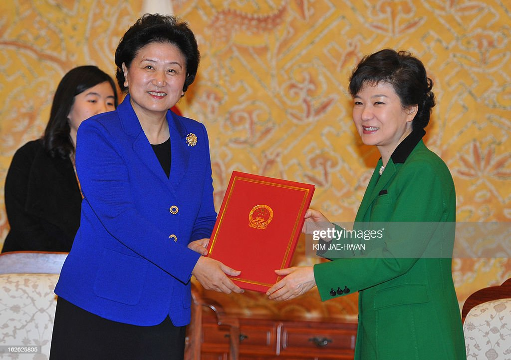 South Korea's incoming president Park Geun-Hye (R) receives letters of Chinese President Hu Jintao and General Secretary of the Communist Party of China Central Committee Xi Jinping 's from Liu Yandong, an official of the Communist Party of China, at the presidential Blue House in Seoul on February 25, 2013. Park Geun-Hye became South Korea's first female president on February 25, vowing zero tolerance with North Korean provocation and demanding Pyongyang 'abandon its nuclear ambitions' immediately.