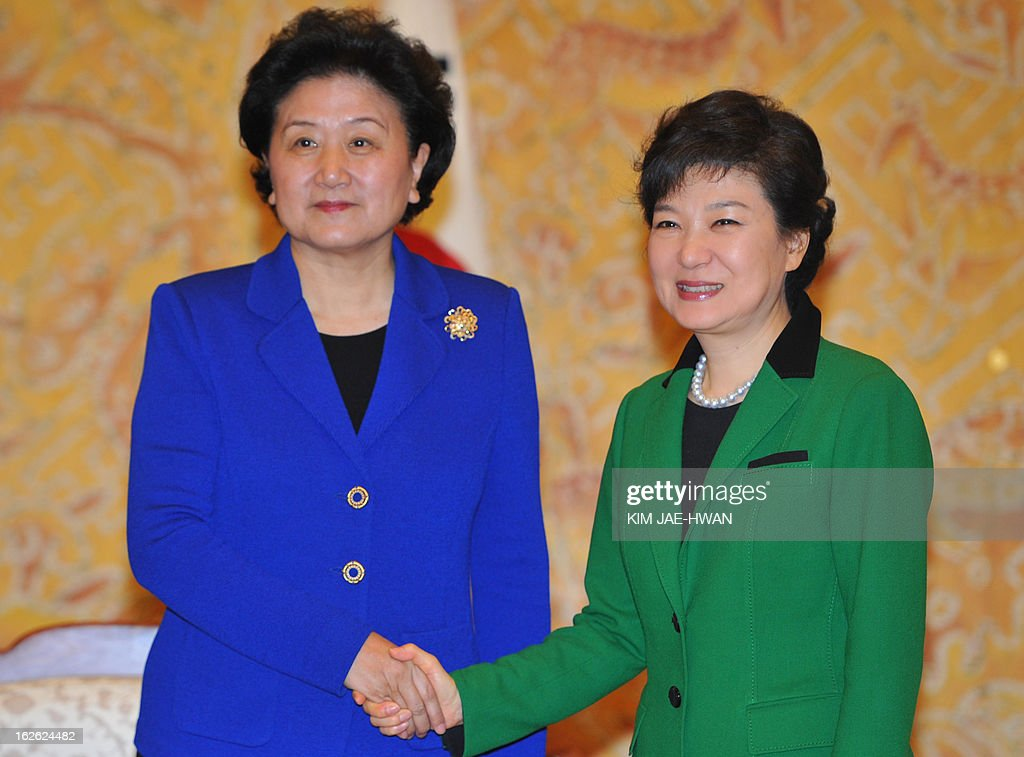 South Korea's incoming president Park Geun-Hye (R) shakes hands with Liu Yandong, official of the Communist Party of China, at the presidential Blue House in Seoul on February 25, 2013. Park Geun-Hye became South Korea's first female president on February 25, vowing zero tolerance with North Korean provocation and demanding Pyongyang 'abandon its nuclear ambitions' immediately. AFP PHOTO / POOL / KIM JAE-HWAN