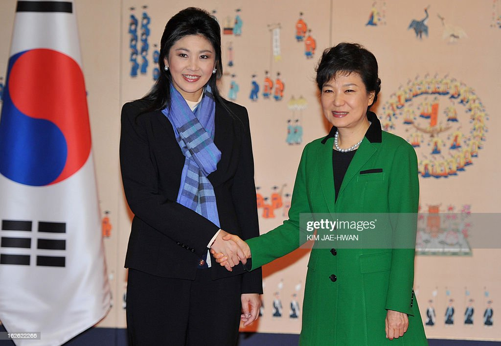 South Korea's incoming president Park Geun-Hye (R) shakes hands with Thai Prime Minister Yingluck Shinawatra at the presidential Blue House in Seoul on February 25, 2013. Park Geun-Hye became South Korea's first female president on February 25, vowing zero tolerance with North Korean provocation and demanding Pyongyang 'abandon its nuclear ambitions' immediately. AFP PHOTO / POOL / KIM JAE-HWAN