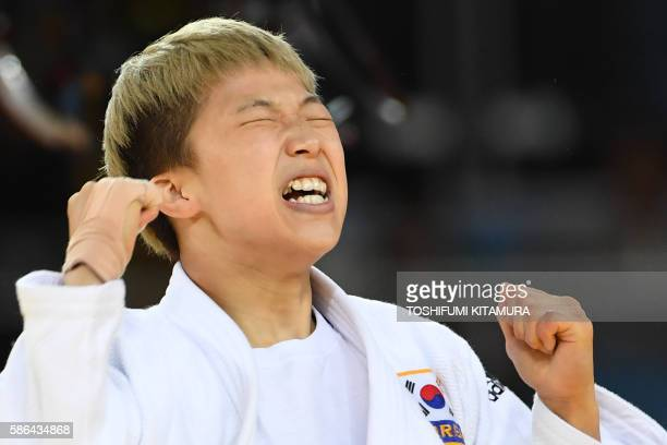 TOPSHOT South Korea's Jeong Bokyeong reacts after defeating Cuba's Dayaris Mestre Alvarez in their women's 48kg judo contest semifinal A match of the...