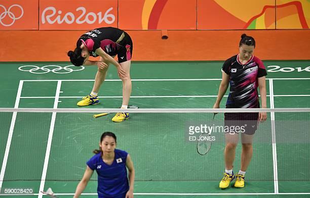 South Korea's Jung Kyung Eun and South Korea's Shin Seung Chan react against Japan's Misaki Matsutomo and Japan's Ayaka Takahashi during their...