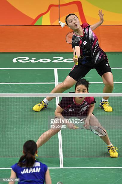 South Korea's Jung Kyung Eun and South Korea's Shin Seung Chan return to Japan's Misaki Matsutomo and Japan's Ayaka Takahashi during their women's...