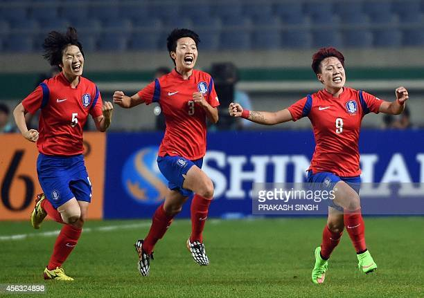 South Korea's Jung Seolbin celebrates a goal against North Korea with teammates Kim Doyeon and Kim Hyeri during their women's football semifinal...