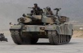 South Korea's K1 battle tank from 26th Infantry division move a posision during the United States and South Korean Joint live fire Exercise at...