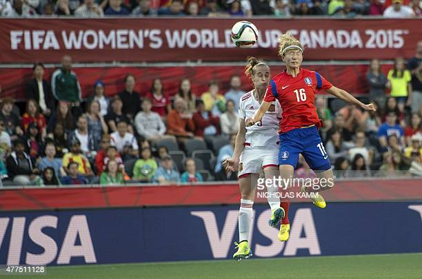 South Korea's Kang Yumi and Spain's Leire Landa fight for the ball during a 2015 FIFA Women's World Cup Group E match at Lansdowne Stadium in Ottawa...