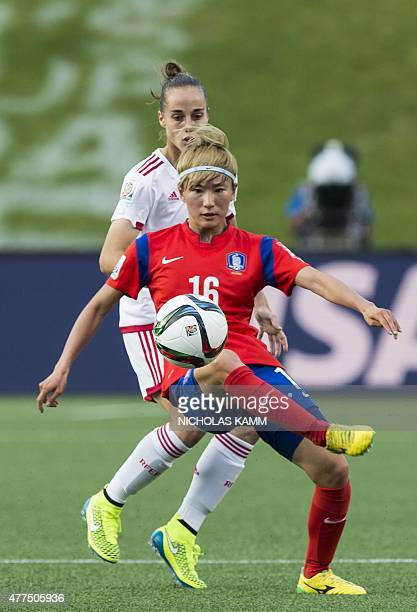 South Korea's Kang Yumi controls the ball in front of Spain's Leire Landa during a 2015 FIFA Women's World Cup Group E match at Lansdowne Stadium in...