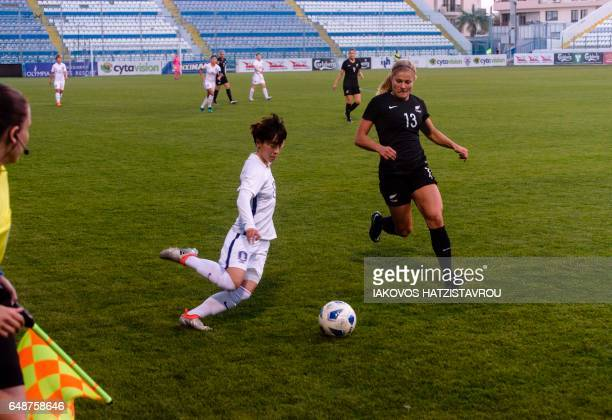 South Korea's Kang Yumi dribbles past New Zealand's Rosie White during the Cyprus Women's Cup football match between South Korea and New Zealand on...