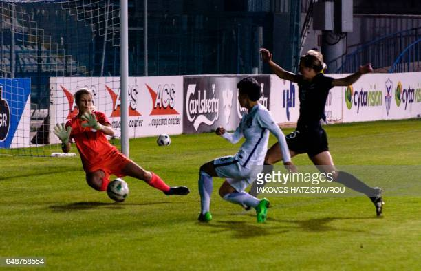 South Korea's Kang Yumi fights for the ball against New Zealand's goalpost during the Cyprus Women's Cup football match between South Korea and New...