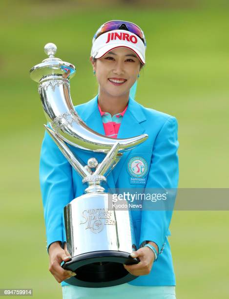South Korea's Kim Ha Neul poses with the trophy after winning the Suntory Ladies Open golf tournament at Rokko Kokusai Golf Club in Kobe on June 11...