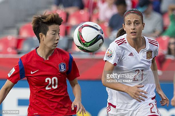South Korea's Kim Hyeri and Spain's Alexia Putellas fight for the ball during a 2015 FIFA Women's World Cup Group E football match at Lansdowne...