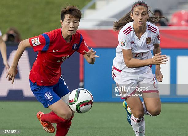 South Korea's Kim Hyeri and Spain's Alexia Putellas fight for the ball during a 2015 FIFA Women's World Cup Group E match at Lansdowne Stadium in...