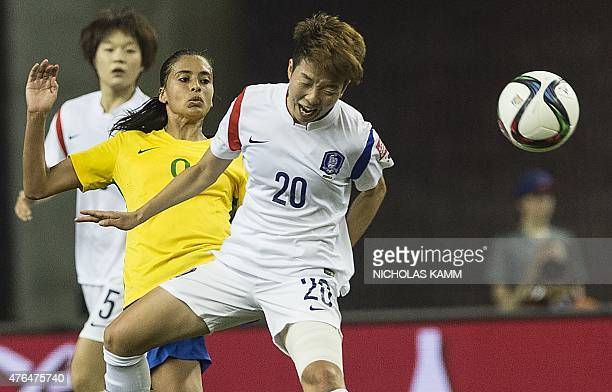 South Korea's Kim Hyeri heads the ball in front of Brazil's Andressa Alves during a Group E match at the 2015 FIFA Women's World Cup at the Olympic...