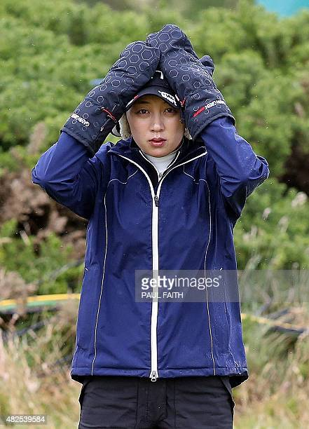South Korea's Kim Hyo Joo warms her hands in mittens before playing her shot onto the 14th green as she plays in the second round of the Women's...