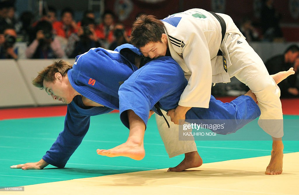 South Korea's Kim Jae-Bum (R) lifts Russia's Ivan Vorobev during their men's 81kg class final match of the Grand Slam judo tournament at Yoyogi National Gymnasium in Tokyo on December 1, 2012. Kim won the final match.