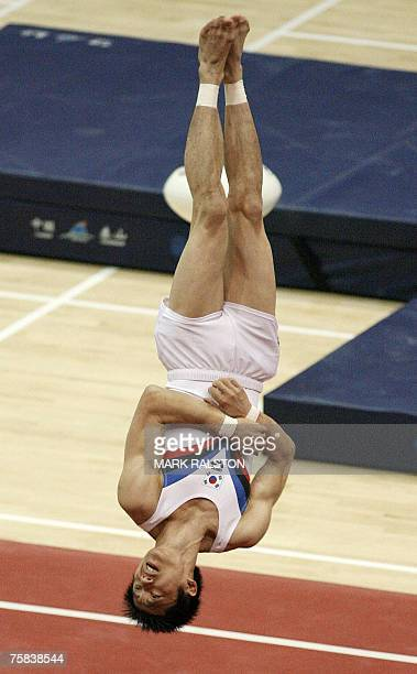 South Korea's Kim Ji Hoon performs a somersault on his way to finishing third during the men's floor event at the finals of the FIG 2007 World Cup...