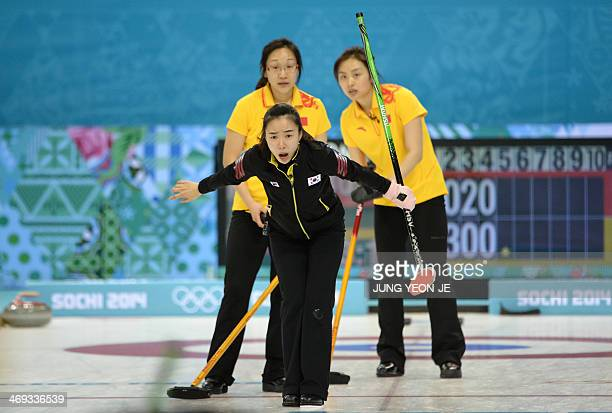 South Korea's Kim JiSun shouts directions after releasing the stone during the Women's Curling Round Robin Session 7 against China at the Ice Cube...